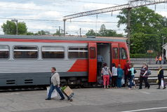 Passengers boarding in the RA-1 rail bus at Bryansk station. Stock Photo