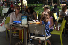 Bryant Park Games. New York, NY USA -- Aug 3, 2016  New Yorkers playing board games in Bryant Park at lunchtime. Editorial Use Only Stock Photography