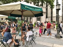 Bryant Park New York City Tourist Attraction and People Having Fun Family Destination stock photo
