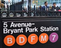 Bryant Park NewYork Subway Sign Business Men Corporate Workers in the Background royalty free stock photography