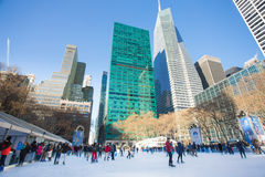 Bryant Park NYC Christmastime. NEW YORK CITY - DEC 13: Ice skaters on Citi Pond in midtown Manhattan on Dec 13, 2013. This popular park is located behind NY Royalty Free Stock Image