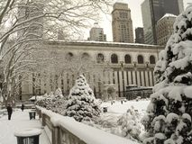 Bryant Park in Winter. This is a shot of Bryant Park In Manhattan during a snow storm, The New York Public Library can be seen in the background royalty free stock images