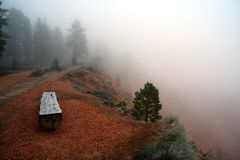 Bryce Canyon Fog. A bench in early morning fog on the rim of Bryce Canyon National Park, Utah, USA Royalty Free Stock Photos