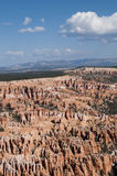 Bryce Canyon Hoodoos Mountain Landscape. Bryce Canyon Hoodoo mountain vista with clouds in Utah Stock Photo