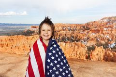 Bryce Canyon National Park and boy with USA flag Stock Photography