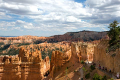 Bryce Canyon National Park Hoodoos Tourists Utah. BRYCE CANYON NATIONAL PARK, UTAH, USA - AUGUST 16, 2015: Tourists climb the trails as they view the hoodoos in Stock Photos