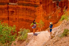 BRYCE CANYON, UTAH, JUNE, 07, 2018: Hikers in Bryce Canyon hiking in beautiful nature landscape with hoodoos, pinnacles stock photo