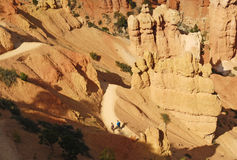 Bryce Hikers. Hikers on a trail in a landscape image of sandstone rock spires in Bryce Canyon National Park, Utah Royalty Free Stock Photography