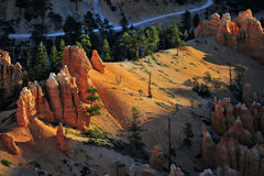 Bryce National Park Radiant Rocks & Hoodoos. Radiant sunlight sets the sculpted red rocks and hoodoos on fire with a glowing light Royalty Free Stock Photography