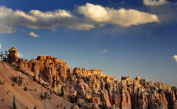 Bryce National Park Radiant Rocks & Hoodoos. Radiant sunlight sets the sculpted red rocks and hoodoos on fire with a glowing light Stock Photo