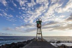 Brygga och fyr i Saint Pierre, La Reunion Island Royaltyfri Foto