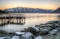 Brygga på solnedgången Fotografering för Bildbyråer
