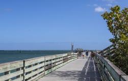 Brygga på stranden Fotografering för Bildbyråer