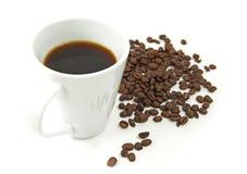 Kaffe och kaffebönor Royaltyfri Fotografi