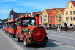 Bryggen and Bergen tourist train Stock Photography