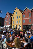 Bryggen, hanseatic league houses in Bergen - Norway. Bryggen, colorful hanseatic league houses of Bergen's landmark - Norway, with lots of people sitting in a Royalty Free Stock Photo