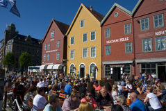 Bryggen, hanseatic league houses in Bergen - Norway. Bryggen, colorful hanseatic league houses of Bergen's landmark - Norway, with lots of people sitting in a Royalty Free Stock Photography