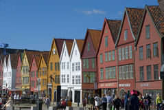 Bryggen, hanseatic league houses in Bergen - Norway. Bryggen, colorful hanseatic league houses of Bergen's landmark - Norway, with lots of people walking along Royalty Free Stock Photography