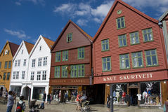 Bryggen, hanseatic league houses in Bergen - Norway. Bryggen, colorful hanseatic league houses of Bergen's landmark - Norway, with people walking along Royalty Free Stock Photos