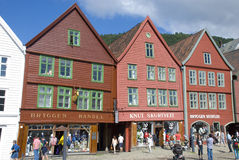 Bryggen, hanseatic league houses in Bergen - Norway. Bryggen, colorful hanseatic league houses of Bergen's landmark - Norway, with people walking along Stock Image