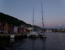 Bryggen, the historic harbor district of Bergen on the full moon night, Norway Royalty Free Stock Photos