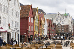 Bryggen street with wooden colored houses Stock Images