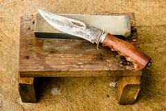 Bryne och kniv Arkivbild