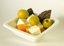Brynza and green olives Royalty Free Stock Photography