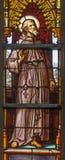 Bryssel - St Francis av Assisi på windwopane från 19 cent i domkyrkan av St Michael och st Gudula Royaltyfri Foto