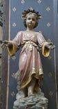 Bryssel - ung Jesus staty Arkivbild