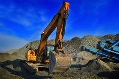 Bryta grävaren Arkivfoto