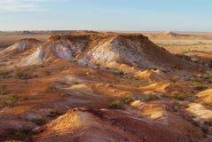 Brytningreserven nära Coober Pedy på solnedgången i södra Australien, Australien Royaltyfri Foto