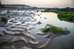 Brytyjski plaża przy niskim przypływem po zmierzchu, Anglia, UK Fotografia Stock
