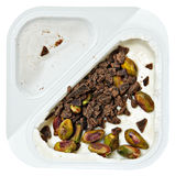 Brzoskwinia Doprawiający Grecki jogurt z Pstachio i czekolada Kropimy zdjęcia royalty free