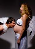 brzuch pocałunek anioła w ciąży Obraz Stock