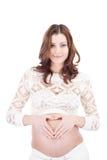brzuch robi serce kobiety ciężarnej szyldowej uśmiechniętej Zdjęcia Stock