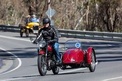 1949 BSA B33 Motorcycle with sidecar on country road. Adelaide, Australia - September 25, 2016: Vintage 1949 BSA B33 Motorcycle with sidecar on country roads Stock Photos
