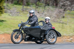 1952 BSA M33 Motorcycle with sidecar on country road. Adelaide, Australia - September 25, 2016: Vintage 1952 BSA M33 Motorcycle with sidecar on country roads Stock Photography