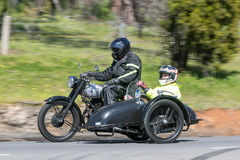 1948 BSA M21 Motorcycle with sidecar on country road. Adelaide, Australia - September 25, 2016: Vintage 1948 BSA M21 Motorcycle with sidecar on country roads Stock Images