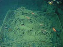 BSA motocycles inside of  This. BSA motorcycle inside of cargo hole in Thistlegorm wreck, 3 bikes on top platform    of Bedford Truck Red Sea, Egypt Royalty Free Stock Photography