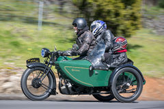 1929 BSA Shoper Motorcycle with sidecar on country road. Adelaide, Australia - September 25, 2016: Vintage 1929 BSA Shoper Motorcycle with sidecar on country Stock Images