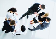 Bästa sikt av affärsfolk med deras händer Arkivbild