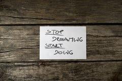 Bästa sikt av ett stopp som drömmer starten som gör meddelandet Fotografering för Bildbyråer