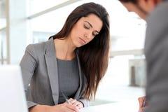 Bsuinesswoman writing a report Stock Photos