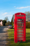 BT telephone box in a Suffolk Village, UK Royalty Free Stock Photography