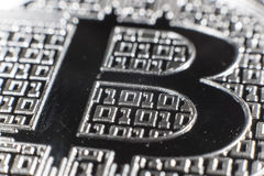 BTC Bitcoin coin detail. Shining metal BTC bitcoin coin, detail with zeros and ones Stock Image