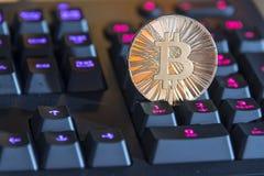 BTC Bitcoin coin on keyboard Stock Photography