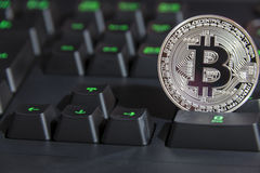 BTC Bitcoin coin on keyboard Stock Images