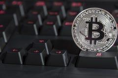 BTC Bitcoin coin on keyboard Royalty Free Stock Photo