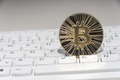 BTC Bitcoin coin on keyboard Royalty Free Stock Photos
